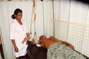 Rohan receiving physiotherapy